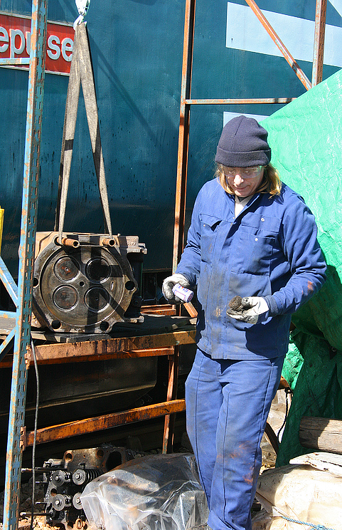 Dave Rolfe with a cylinder head on the hoist