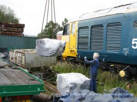 Spare traction motor being unloaded
