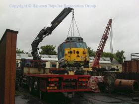 50037's cab is seen being moved into a more convenient position on the SRPS site at Boness